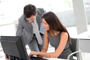 Business people in office working on desktop computer